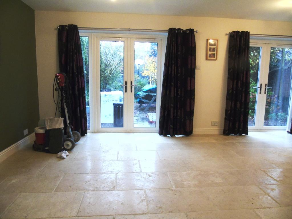 Limestone Tiled Lounge Floor Before Cleaning in Vale Gloucestershire
