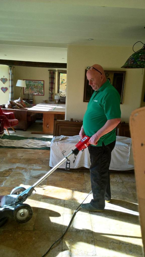 Travertine Kitchen Floor in Greet During Cleaning