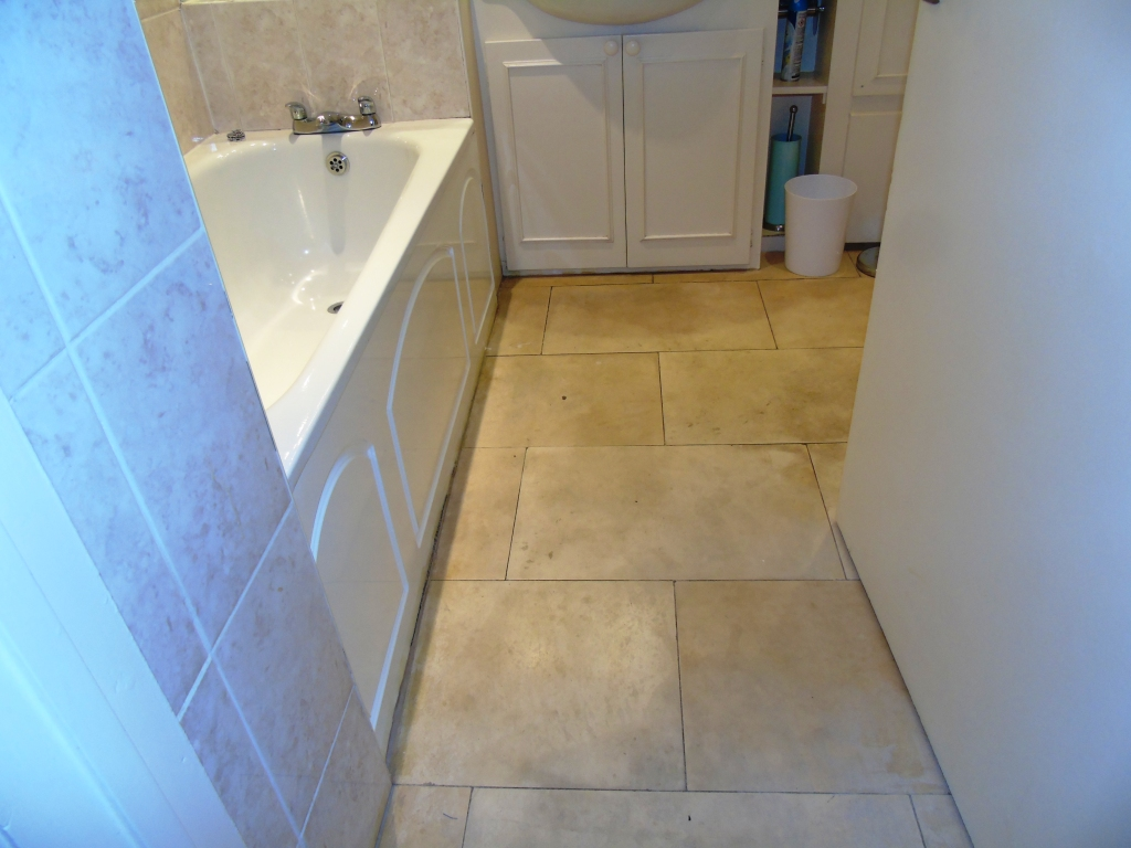 Limestone Bathroom Floor Before Cleaning Cirencester