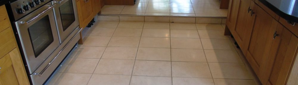 Restoring Limestone Tiles Sealed With Brown Wood Sealer in Tewksbury