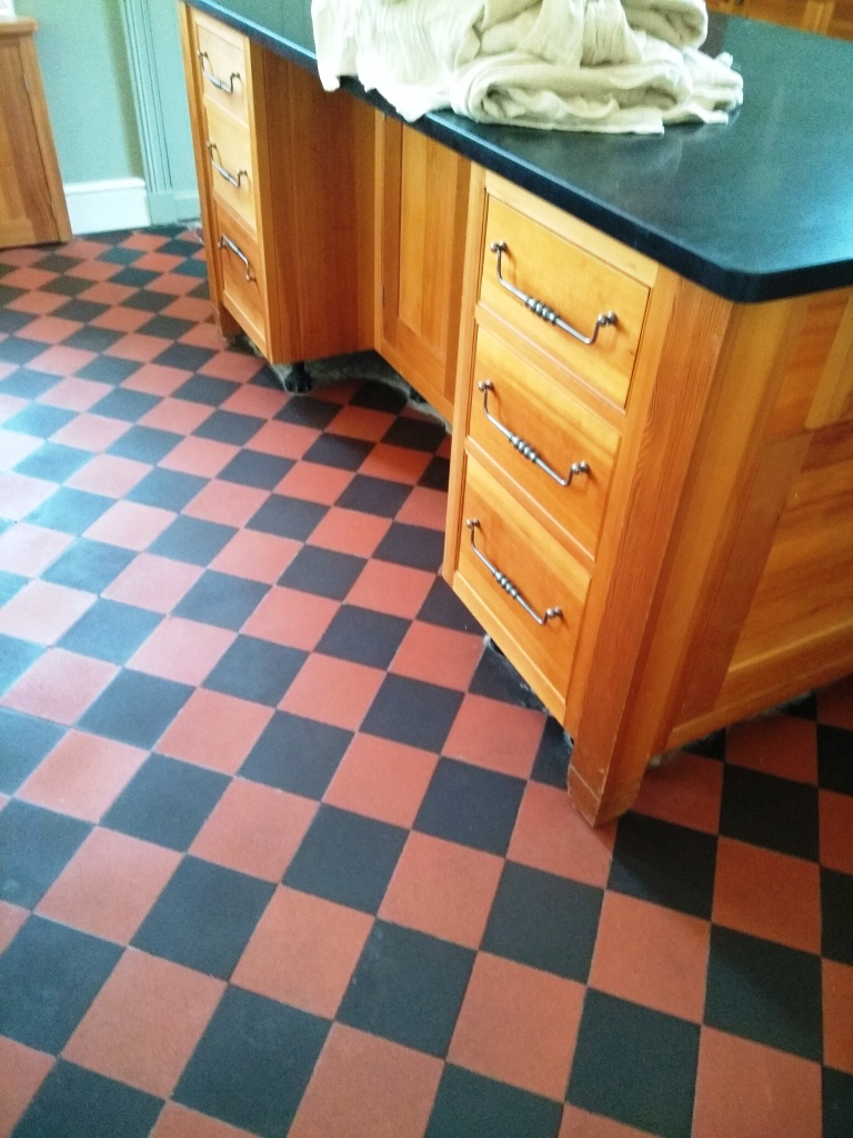Lino Covered Quarry Tiled Kitchen Floor After Restoration in Filton