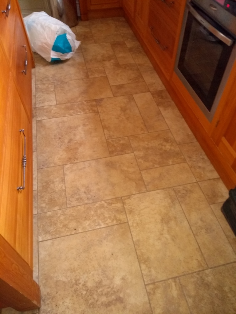 Lino Covered Quarry Tiled Kitchen Floor Before Restoration in Filton