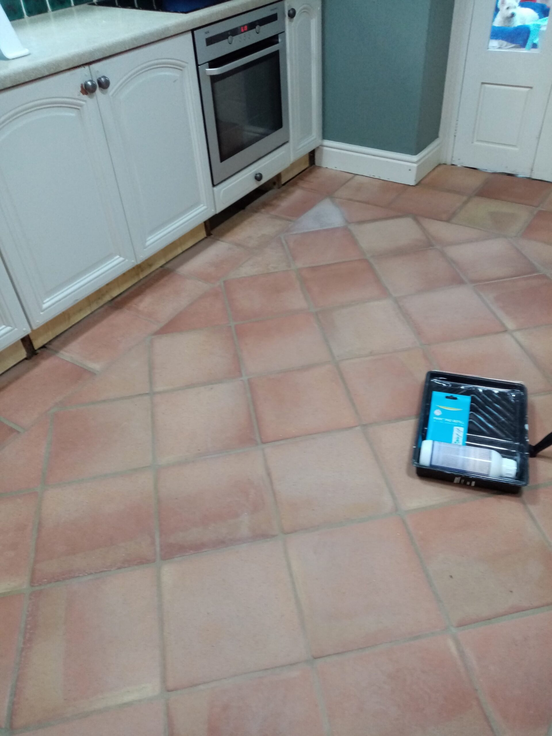 Flood Stained Terracotta Floor Before Cleaning Gloucester